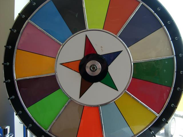 Where to find GAMBLING WHEEL-COLORS W  MAT in Baltimore